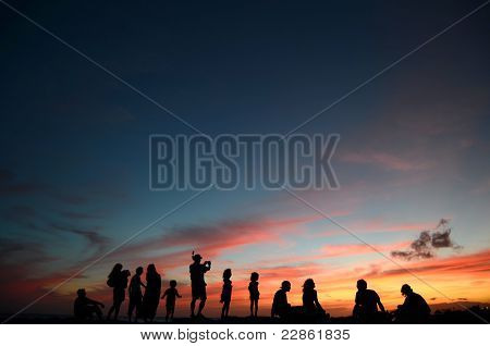Family And Friends At Sunset