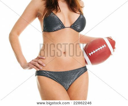 Beautilful woman posing with football ball