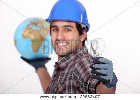 Man holding globe and light bulb