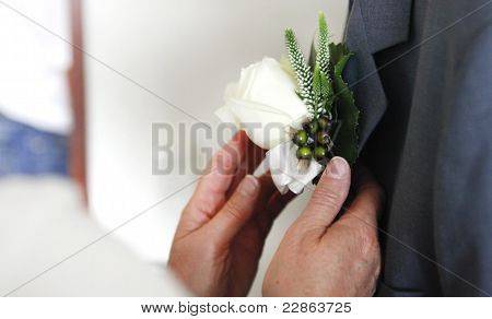 Pinning A Corsage