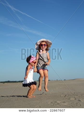 two happy little girl jumping