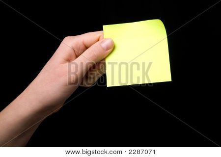 Holding A Sticky Note