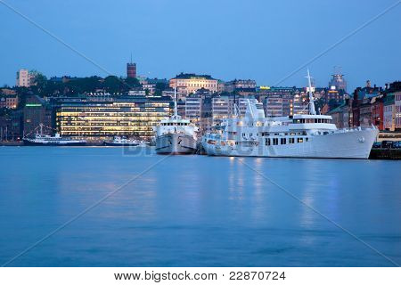Stockholm, Sweden at night. Waterfront, ships, architecture