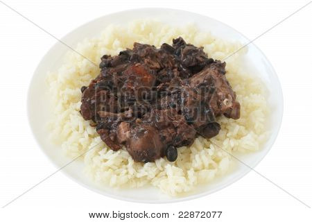 Meat with sausages and beans on rice