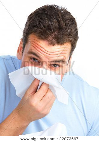 Young man having allergy. Isolated ove rwhite background.