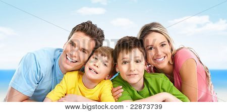 Happy family. Father, mother and boy. Over blue background