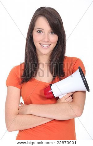 Smiling young woman with a loudspeaker