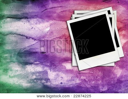 some blank retro photo frames on a colorful background