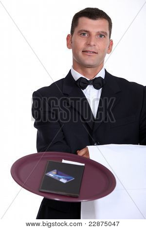 Waiter with the bill and a credit card