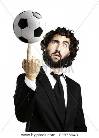 portrait of young man playing with a soccer ball