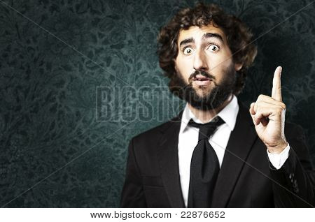 young business man pointing up against a grunge background
