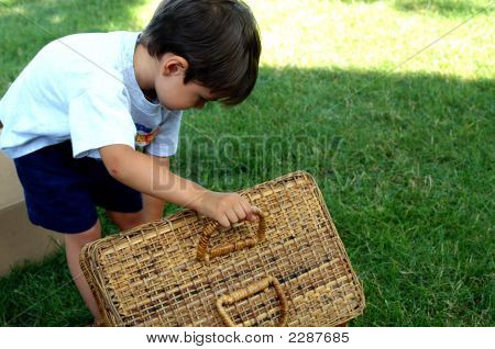 Little Boy And Picnic Basket