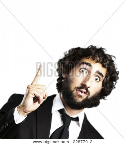 portrait of young business man pointing up against a white background