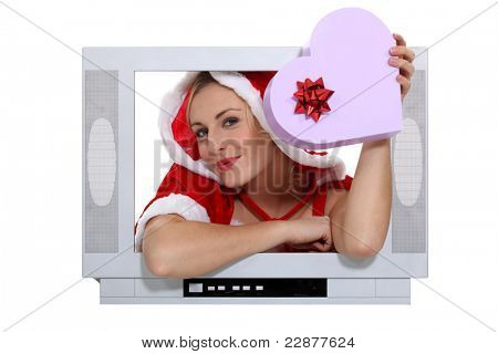 Woman jutting out of a television screen