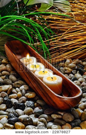 Candles Burning In Wood Vessel In A Holistic Spa