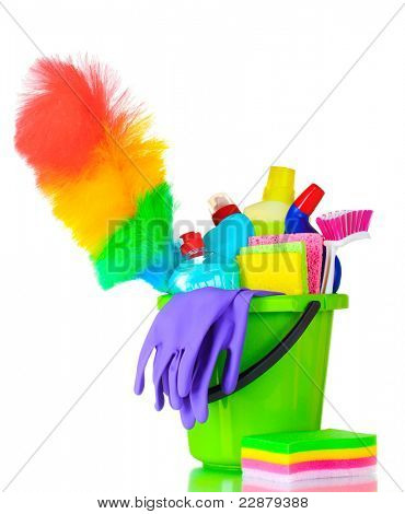 detergent bottles, brush, gloves and sponges in bucket isolated on white
