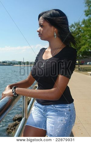 Young Woman Looking across lake