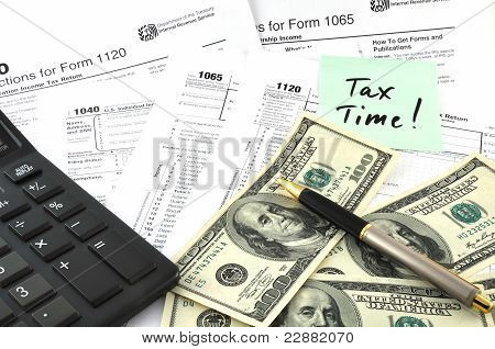 Tax Time. Concept Image With Calculator, Money And Tax Return Forms As A Background
