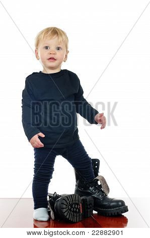 Little Boy And Big Shoes