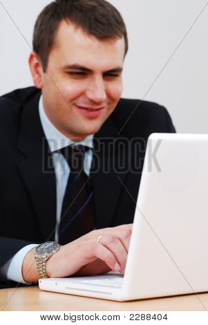 Young Businessman Working On A Lap-Top