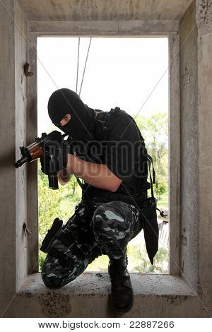 Soldier In Mask Entering The Window With Ak-47 Rifle