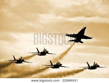 Silhouetted Supersonic Jet Fighters