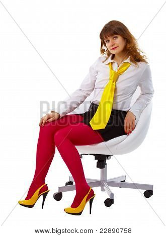 Beautiful Woman In Bright Clothes In A Chair