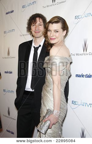 BEVERLY HILLS - JAN 16: Milla Jovovich, Paul W.S. Anderson at The Weinstein Company And Relativity Media's 2011 Golden Globe Awards Party in Beverly Hills, California on January 16, 2011