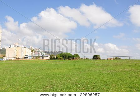 Green foreland and blue sky