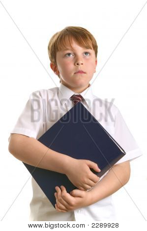 Schoolboy Holding A Book