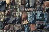 Colored Cobblestone Wall Texture. Stone Wall From Cobblestone Background For Design. Modern Stone Wa poster
