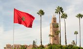 Red Flag With Palms From Morocco And Djemma El Fna Tower. Touristic Place In Marrakesh Used By Local poster
