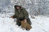image of jagdterrier  - A hunter with a dog in winter forest - JPG