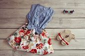 Beautiful Childrens Jeans Dress And Sandals On A White Wooden Background poster