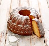 Easter Yeast Cake Sprinkled With Powdered Sugar On A Wooden White Table. Traditional Polish Easter D poster