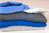 Stack Of Clothing Isolated On White poster