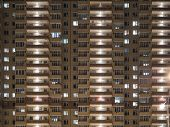 Night View Of Exterior Apartment Building. High Rise Apartments In Night Light poster