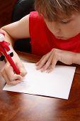 Постер, плакат: Ребенка писать A письмо
