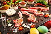 Raw Lamb Ribs Preparation On Rustic Cutting Board - Fresh Chops Of Meat With Colorful Spices And Veg poster