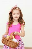 Portrait Of Little Girl Holding Easter Basket Of Painted Eggs. Portrait Of Easter Little Girl Holdin poster