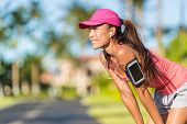 Happy summer running woman runner listening to music on phone sports armband with touchscreen and he poster