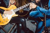 Guitar music teacher helping his student to play, closeup on the hands poster