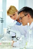 Two clinicians making experiments in laboratory poster