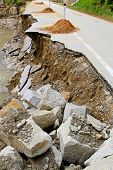stock photo of landslide  - Destroyed road landslide damaged in powerful flood - JPG