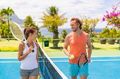 Tennis players friends having fun laughing playing on outdoor court. Couple or mixed double tennis p poster