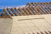 Wooden Roof. House Roof Under Construction. Roofing Construction. Wooden Roof Frame Home Constructio poster