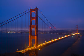 image of golden gate bridge  - Golden Gate Bridge sunset evening with lights of San Francisco California in background - JPG