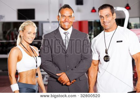 gym manager and trainers group portrait