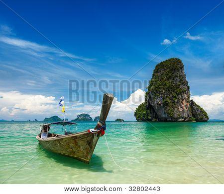 Long tail boat on tropical beach (Pranang beach) and rock, Krabi, Thailand