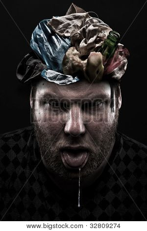 Ignorance concept. Heap of garbage inside silly man head